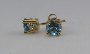 Earrings of Medium dark blue topaz Lone Star cut