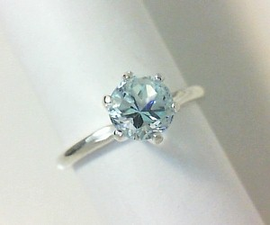 Light blue Lone Star Cut topaz solitaire ring