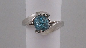 Swirl ring, medium blue Lone Star topaz